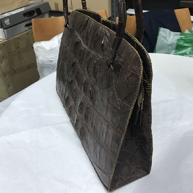 Side of the handbag with minor cracks